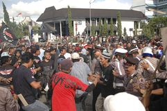 INDONESIAN POLICE CONTROVERSY. A riot handling simulation held by the Indonesian Police in Solo, Java, Indonesia. Indonesian Police are controversially on Royalty Free Stock Photo