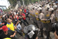 INDONESIAN POLICE CONTROVERSY. A riot handling simulation held by the Indonesian Police in Solo, Java, Indonesia. Indonesian Police are controversially on Stock Photo