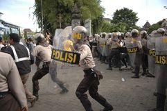 INDONESIAN POLICE CONTROVERSY. A riot handling simulation held by the Indonesian Police in Solo, Java, Indonesia. Indonesian Police are controversially on Royalty Free Stock Image