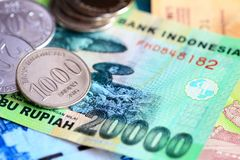 Indonesian rupiah coins and bills close up. Money background Stock Image