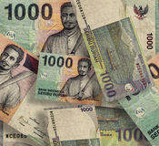 Indonesian Rupiah. A large number of scattered notes Stock Photography