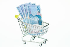 Indonesian rupiah in shopping cart close-up Stock Photos