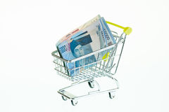 Indonesian rupiah in shopping cart Royalty Free Stock Images