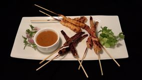 Indonesian satay skewer with dip stock photos
