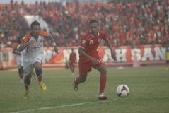 INDONESIAN SOCCER TROUBLES. A local soccer match between Pusamania Borneo FC and Persis Solo, in Manahan Stadium, Solo, Java, Indonesia. Last year the Indonesian Stock Photos