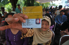 Indonesian Social Protection Card. Poor people show  Social Protection Card while queuing take help in cash money at the Office of Pos, Solo, . The card is one Stock Photography