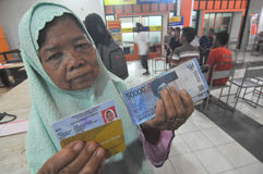 Indonesian Social Protection Card. Poor people Social Protection Card show while queuing take help in cash money at the Office of Pos, Solo, . The card is one of Stock Photo