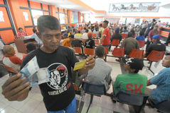 Indonesian Social Protection Card. Poor people Social Protection Card show while queuing take help in cash money at the Office of Pos, Solo, . The card is one of Stock Images