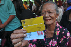 Indonesian Social Protection Card. Poor people Social Protection Card show while queuing take help in cash money at the Office of Pos, Solo, . The card is one of Stock Photography