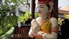 Indonesian Statue Praying 4k. An Indonesian statue praying. 4k footage stock video