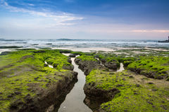 Indonesian temple in sea with tourist. Tanah lot complex. Bali. Royalty Free Stock Image