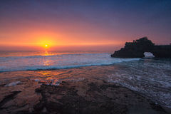 Indonesian temple in sea with tourist. Tanah lot complex. Bali. Royalty Free Stock Photography