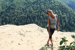 Tourist watching on Thomas´s View in Slovak Paradise. Indonesian tourist - smiling young Papuan girl standing on viewpoint Thomas´s View with sharp edge stock photos
