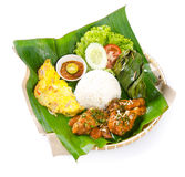 Indonesian traditional food, chicken, fish and vegetables Stock Photo