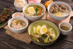 Indonesian traditional food. Lontong sayur with bakso soto and bubur ayam on a table royalty free stock image