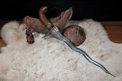 Indonesian Traditional Weapon, Antique typical Indonesian kris knife, on tanned skin stock photography