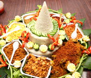 Indonesian Tumpeng. Tumpeng is a cone-shaped rice dish like mountain with its side dishes (vegetables and meat). Traditionally featured in the slamatan ceremony Stock Photography