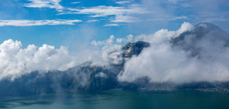 Indonesian Volcano Agung in Bali island. Mountain landscape in tropical panorama. A couple hours Just after Sunrise hike with fluffy white clouds. Viewpoint stock image