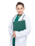 Indonesian woman doctor hold clipboard Royalty Free Stock Photography