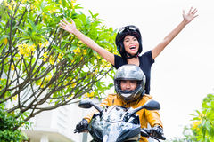 Indonesian woman feeling free on motorcycle Stock Photography