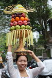 Indonesian woman with fruit-bedecked hat Royalty Free Stock Photography