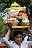 Indonesian woman with fruit-bedecked hat Stock Images