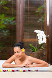 Indonesian woman having wellness bath in spa Stock Photo