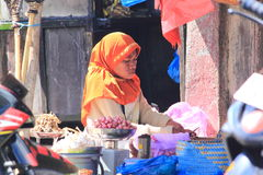 Indonesian woman at market Stock Photography