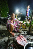 Indonesian Woman prepares the daily catch Stock Photo