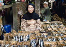 Indonesian woman selling dried fish at the market Royalty Free Stock Image