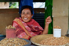 Indonesian Woman Selling Dried Fishes Royalty Free Stock Photo