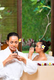 Indonesian women having wellness bath drinking tea Royalty Free Stock Photos