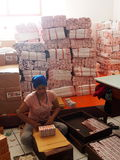 Indonesian Worker Packing Cartons Of Cigarettes Royalty Free Stock Photography