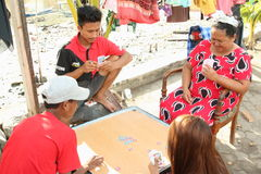 Indonesians playing cards Stock Photography