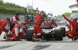 Indonesien-ändernde Reifen des Team-A1 am pitstop. stockfotografie