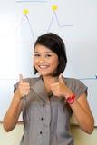 Indonesische Geschäftsfrau in der Agentur Stockfotos