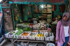 Indonesischer Gemüseverkäufer stockfotografie