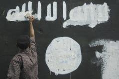 INDONESISK INTELLIGENS ATT HÅLLA ÖGONEN PÅ DEN EXTREMISTISKA GRUPPEN PÅ ISLAMISK STATFRÅGOR Royaltyfria Bilder
