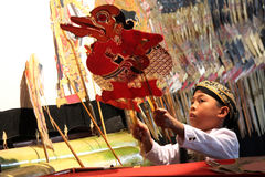 Indonesiska barns Dalang Wayang Royaltyfri Bild