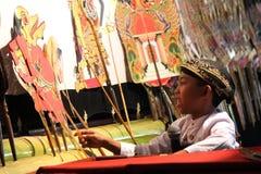 Indonesiska barns Dalang Wayang Fotografering för Bildbyråer