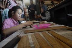 INDONESISKA FORNTIDA SNIRKELFINANSIERINGBEHOV Arkivbild