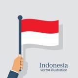 Indonezja flaga mienie w ręka mężczyzna Zdjęcia Stock