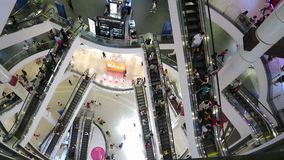 Indoor above view of escalator and people shop in Terminal Shopping Mall, It is one of the big shopping centre in Bangkok
