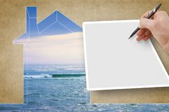 Indoor air quality concept image with a outline of a small house against the sea and hand writing on a blank sheet - Image with. Copy space stock image