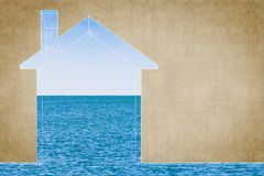 Indoor air quality concept image with a outline of a small house against the sea - Image with copy space.  stock image