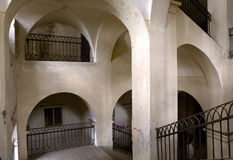 Indoor arches. Interior of an old administrative building in Romania Royalty Free Stock Image