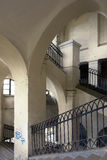 Indoor arches. Interior of an old administrative building in Romania Stock Photography