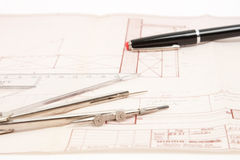 Indoor architecture construction plan. Indoor construction plan in red with pencil, ruler and compass Royalty Free Stock Image