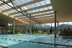 Indoor architecture of public swim bath. With laps and glass roof Stock Image