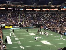Indoor Arena Football with the Arizona Rattlers in Phoenix Arrizona. Professional indoor football is an exciting fast-paced action game played with different Stock Photos